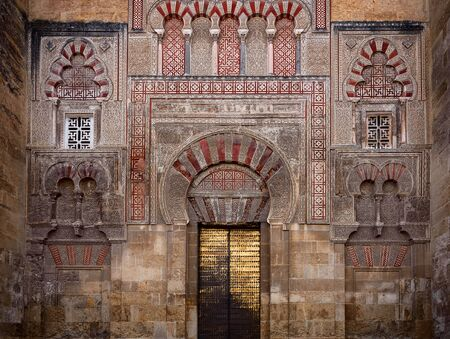 view of an old door of the external wall of the mezquita in cordoba. andalusia. spain