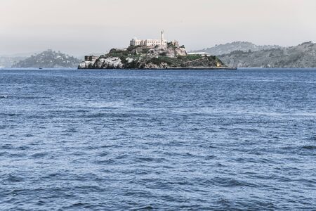 view of the historic site of alcatraz in san francisco from the city pier during a summer day. united states