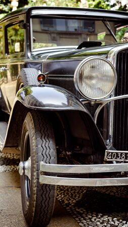 close up of an historic car from the beginning of xx century.