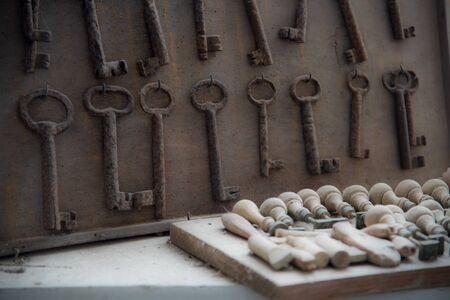 still life with old rusted keys and vintage stamp