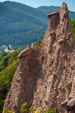 view of the segonzanos pyramids, a geological rocks formation typical of cembras valley, alps, italy
