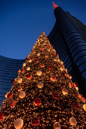 view of the christmas tree in  gae aulenti square, milan. italy