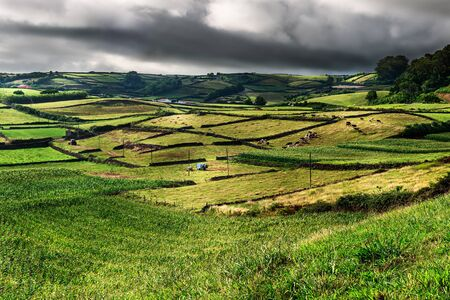 view of the green landscape in terceira, azores, portugal. Stok Fotoğraf
