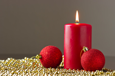 candle with christmas ball photo