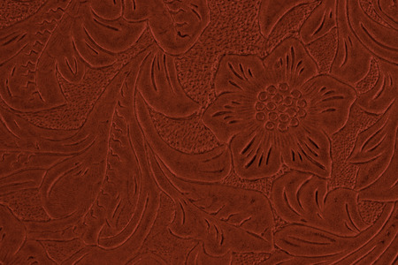 tooled leather: red floral pattern Stock Photo
