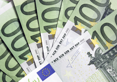 one hundred euro banknote: European dollars scattered on background Stock Photo