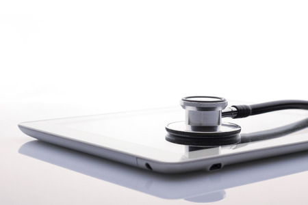 stethoscope and tablet Imagens