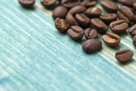 coffeetree: Coffee beans on blue wood background