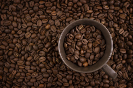blend: cup of  coffee with beans