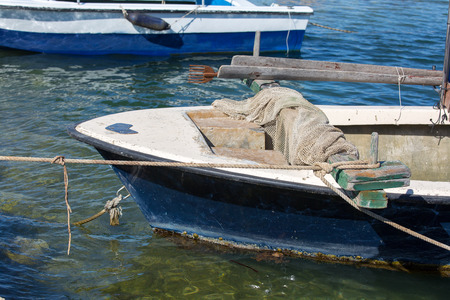 commercial fishing net: wooden fishing boat with fishing net