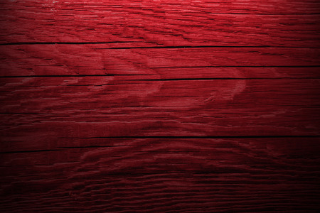 Dark red wooden background.