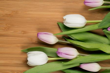 loveliness: Beautiful pink tulips  on wooden background Stock Photo