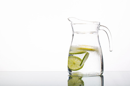 Cold drink with ice and a slice of lemon