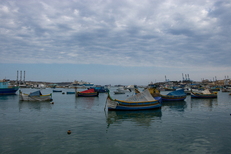 MARSAXLOKK, MALTA - AUGUST 07, 2018: Harbor of Marsaxlokk village in Malta with fishing boats. Editorial