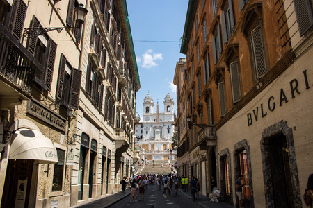 Rome, Italy - July 24, 2018: Via dei Condotti and the Spanish Steps. Via dei Condotti is a street in the center of Rome with the most important fashion brands.