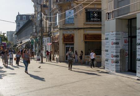 BUCHAREST, ROMANIA - AUGUST 13, 2018: people walking on the street in the city of Bucharest, Romania. Editöryel