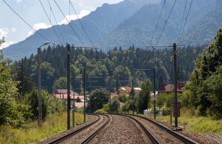 BUSTENI, ROMANIA - AUGUST 16, 2018: railway line in a spectacular mountain landscape in Busteni, Romania.