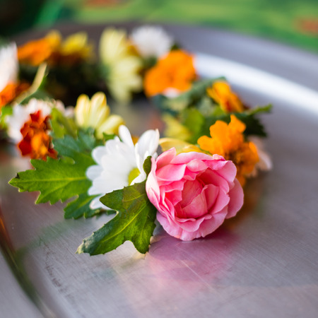 Beautiful necklace of fresh flowers, to be offered to dhuni during the fire ceremony. It is usually offered during the initial part of the ceremony at Shiva Lingam Stock Photo