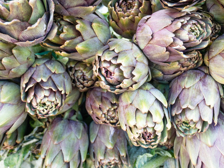 Beautiful background of purple artichokes, coming from organic cultivation. Flatlay view