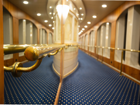 Particular view of a luxurious corridor in a cruise ship. Orizontal view.