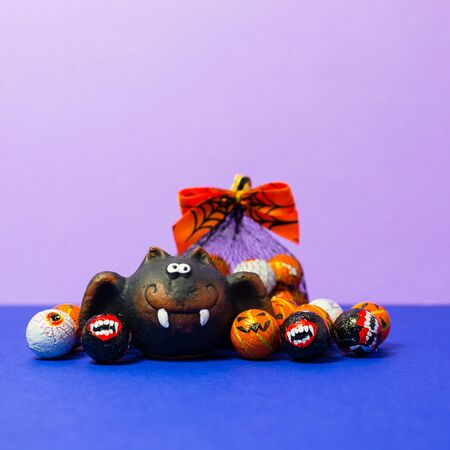 Various typical halloween sweets on a black background. Useful as a background for commercial purposes