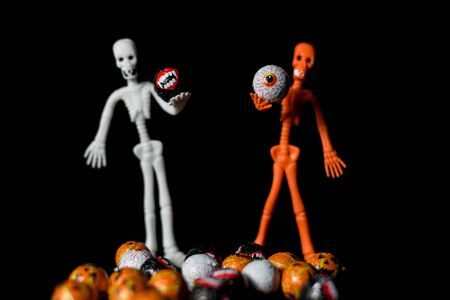 Useful background for halloween, with skeletons, sweets and very colorful pumpkins 스톡 콘텐츠 - 131921635