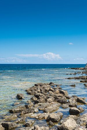 Panoramic view of a beautiful sea on a summer day. Useful for use as a backdrop for advertising in summer vacation resorts. Vertical view