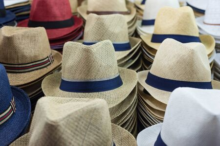 Close-up of different hats for sale for men and women. Horizontal view