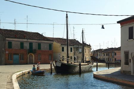 comacchio: Comacchio (Fe),an old typical fishing boat of the Adriatic Sea in a canal of the city
