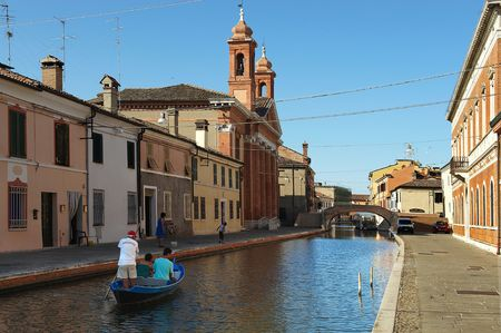 boatman: Comacchio (Fe),Emila Romagna,Italy,a boatman with tourists to tour in the canals of the city