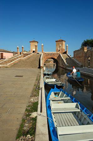 boatman: Comacchio (Fe),Emilia romagna,Italy,the bridge of Trepponti,built in 1634