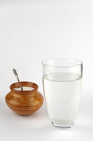 sweetening: a glass of water with sugar
