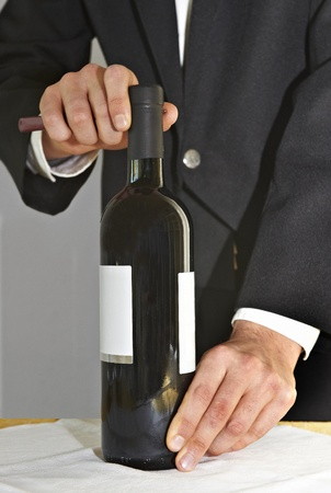 opening a bottle of wine photo