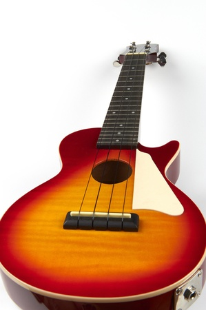 rhythm rhythmic: a ukulele in white background