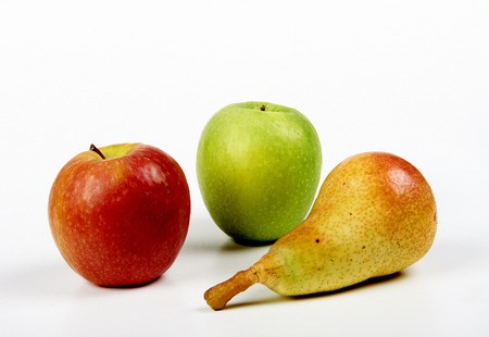 dietology: a pear and two apples on white background Stock Photo