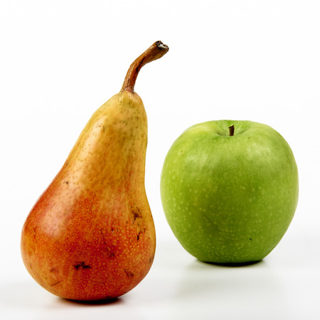 dietology: a pear and an apple on white background