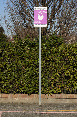 births: Ospitaletto (Bs), Italy,a curious signpost of the parking reserved for pregnant women or new mothers