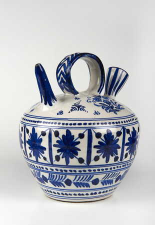 majolica: a majolica vase on white background