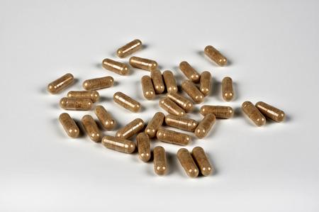 herbolaria: unas pastillas con extractos de hierbas Foto de archivo