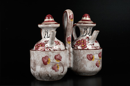 ceramica: a cruet and vinegar cruet made of painted ceramica