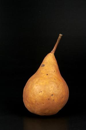 ailment: an organic pear on black background Stock Photo