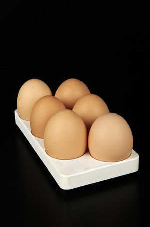 alimentation: some eggs on black background Stock Photo