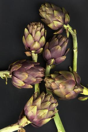 ailment: some artichokes on black background