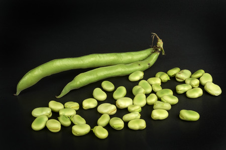 ailment: some organic beans on black background Stock Photo