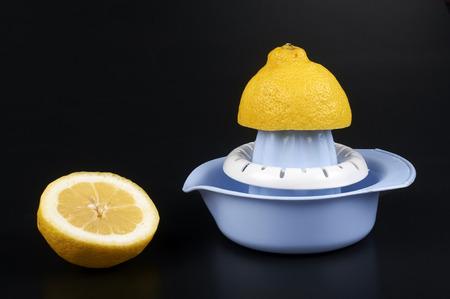 citrus aurantium: a lemon squeezer on a black backgruond Stock Photo