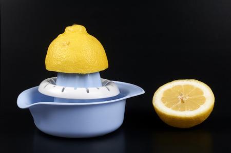 backgruond: a lemon squeezer on a black backgruond Stock Photo