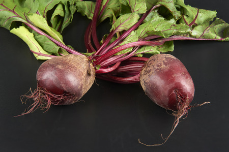 feeders: some red beetroots on black background