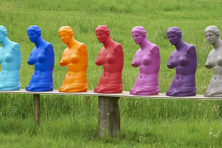 venus: some colorad copies of a statue  of Venus on display in a garden