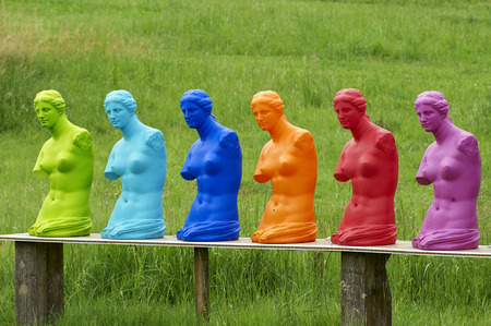 copies: some colorad copies of a statue  of Venus on display in a garden