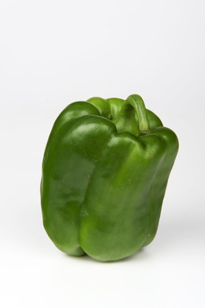 ailment: a biological green pepper on white background